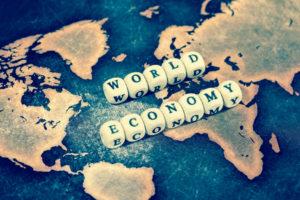 WORLD ECONOMY on grunge world map